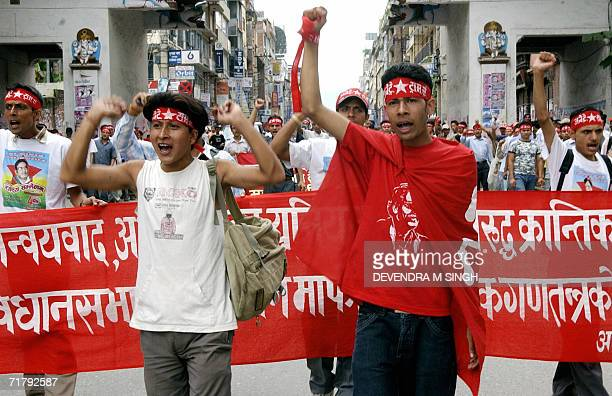 Nepalese Nepalese Maoist activists wearing tshirts with the image of Maoist chairman Prachand shout slogans during a rally in Kathmandu 06 September...