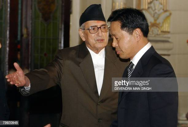 Nepalese Prime Minister Girija Prasad Koirala gestures after receiving the credentials letter from newly appointed Chinese Ambassador to Nepal Zhen...