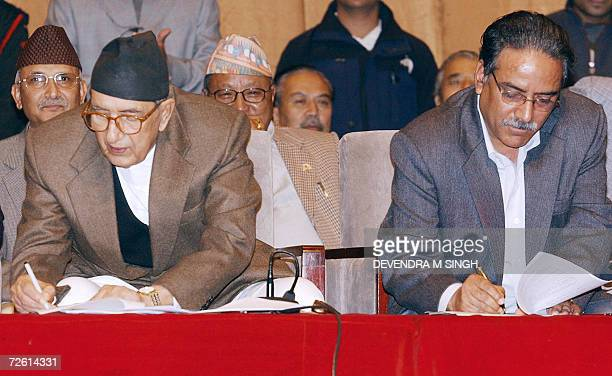 Nepalese Prime Minister Girija Prasad Koirala and Maoist Chairman Prachanda sign a peace agreement in Kathmandu 21 November 2006 Nepal's Maoist...