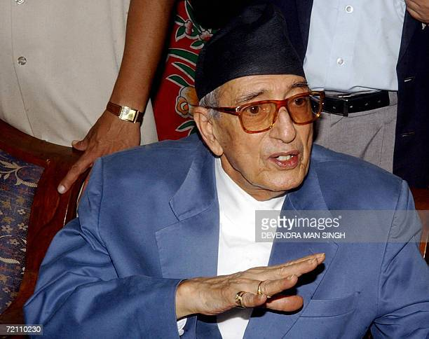 Nepalese Prime Minister Girija Prasad Koirala gestures as he speaks with party officials and delegates in Kathmandu 07 October 2006 at tea party...