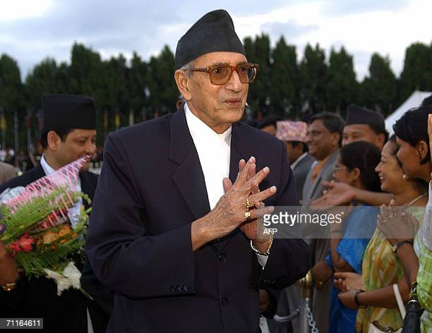 Nepalese Prime Minister Girija Prasad Koirala greets party activists upon his arrival at Tribhuvan International airport in Kathmadu 09 June 2006...