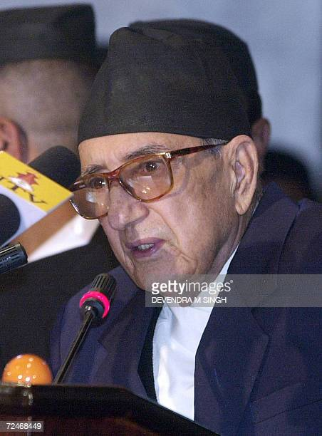 Nepalese Prime Minister Girija Prasad Koirala addresses members of the Parliament about a historic peace deal reached between Maoist rebels and...
