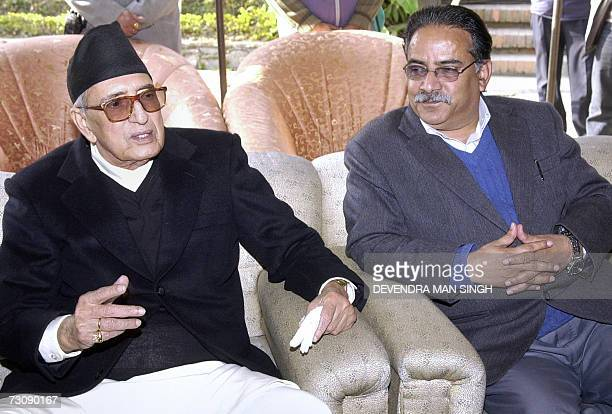 Nepalese Prime Minister Girija Prasad Koirala addresses Members of the Parliament while Maoist Chairman Prachanda listens at a reception in Kathmandu...