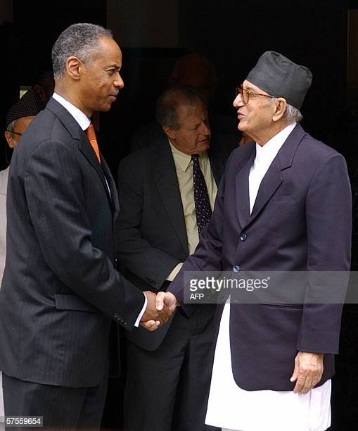 Nepalese Prime Minister Girija Prasad Koirala shakes hand with United Nations Special Advisor to the Under Secretary General for Political Affairs...