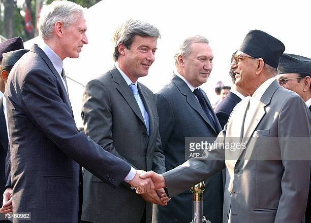 Nepalese Prime Minister Girija Prasad Koirala shakes hands with US Ambassador to Nepal James Moriarty in Kathmandu 01 April 2007 during his departure...