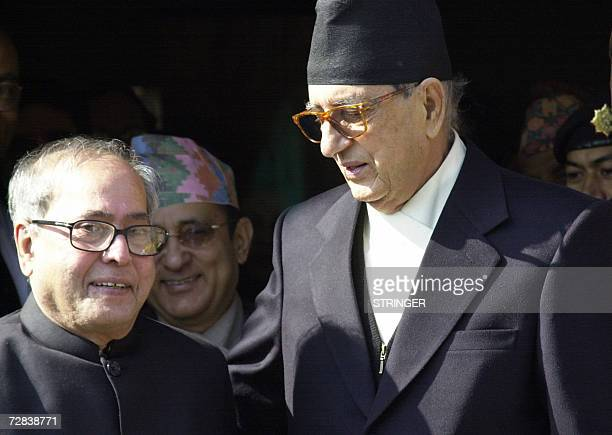 Nepalese Prime Minister Girija Prasad Koirala talks with Indian Foreign Minister Pranab Mukherjee as the two pose for photographers following a...