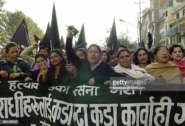 Nepalese women political activists shout slogans during a protest against the killings 14 December of 11 civilians by a soldier who then killed...