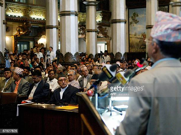 Nepal's new prime minister Girija Prasad Koirala listens to the speech of Communist leader Madhab Nepal during a session of the Parliament in...