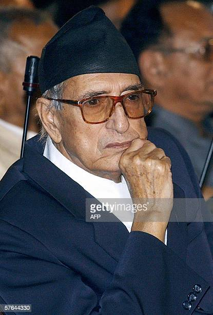 Nepal's Prime Minister Girija Prasad Koirala listens to Speaker of the House of Representatives Subash Newang as he reads a proclamation in the...