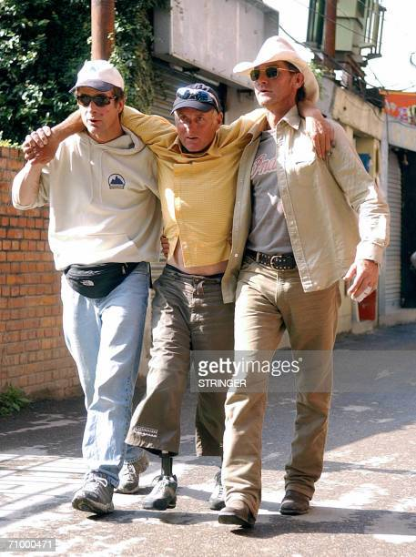 New Zealand's amputee Everest summitter Mark Inglis is helped by colleagues on his way to his hotel upon his arrival from a mountain base camp in...