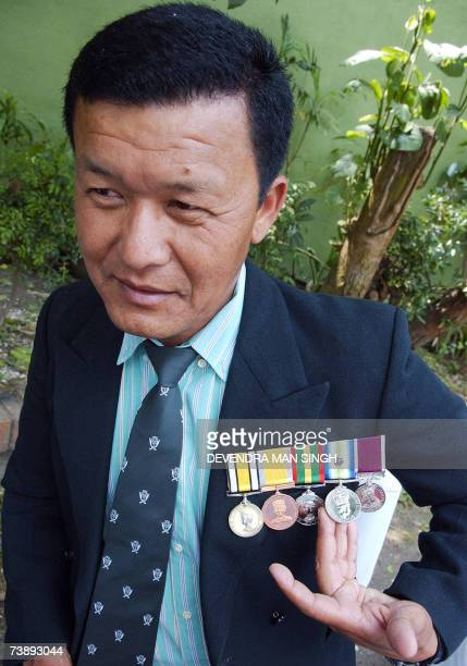 TO GO WITH STORY ARGENTINABRITAINFALKLANDSWARHISTORYNEPALGURKHA BY SAM TAYLOR Nepalese Gurkha San Bahaudr Tamang gestures during an interview in...