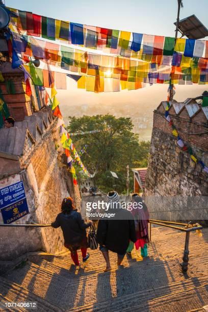 kathmandu prayer flags sunrise on swayambhunath monkey temple pilgrims nepal - kathmandu stock pictures, royalty-free photos & images