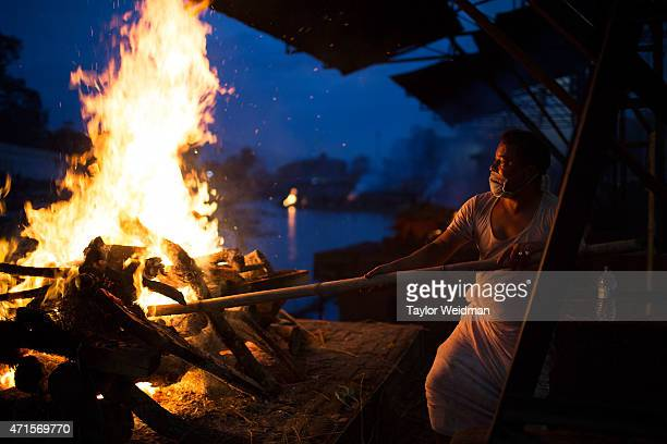 Kathmandu residents perform cremation rituals for loved ones killed in a devastating earthquake at the Pashupatinath Temple in Kathmandu Nepal on...