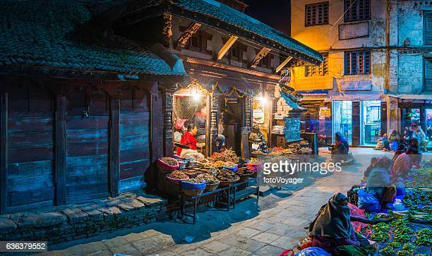 Kathmandu warmly illuminated night market spice sellers Durbar Square Nepal