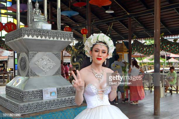 Kathoey a transgender Thai woman poses for visitors at the Floating Market on July 25 2018 in Pattaya on Thailand's eastern Gulf coast The city's...