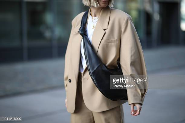 Kathrin Bommann wearing Arket shirt and Zara suit and shoes on March 07 2020 in Cologne Germany