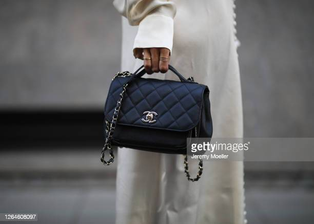 Kathrin Bommann wearing Chanel bag and Envelope 1976 dress on August 07, 2020 in Cologne, Germany.