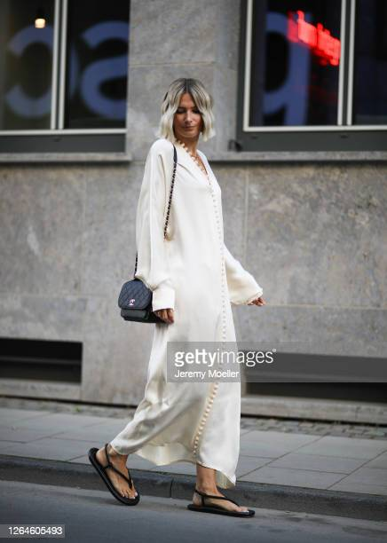 Kathrin Bommann wearing Chanel bag, Zara shoes and Envelope 1976 dress on August 07, 2020 in Cologne, Germany.