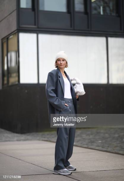 Kathrin Bommann wearing Frankie Shop suit The Sept top Bottega Veneta bag New Balance sneaker and by Aylin König beanie on March 07 2020 in Cologne...