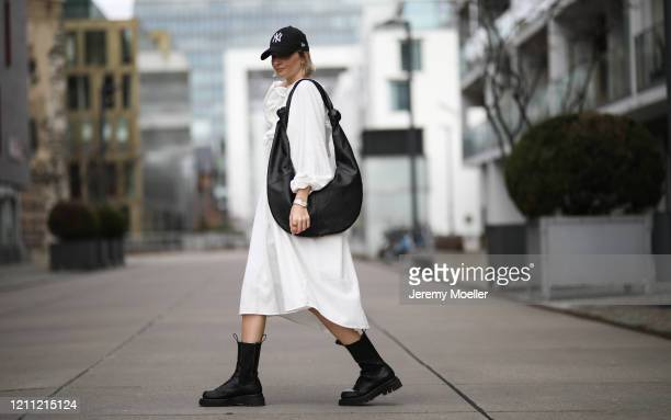 Kathrin Bommann wearing Pixie Shop dress Bottega Veneta boots Frankie Shop bag and New Era cap on March 07 2020 in Cologne Germany