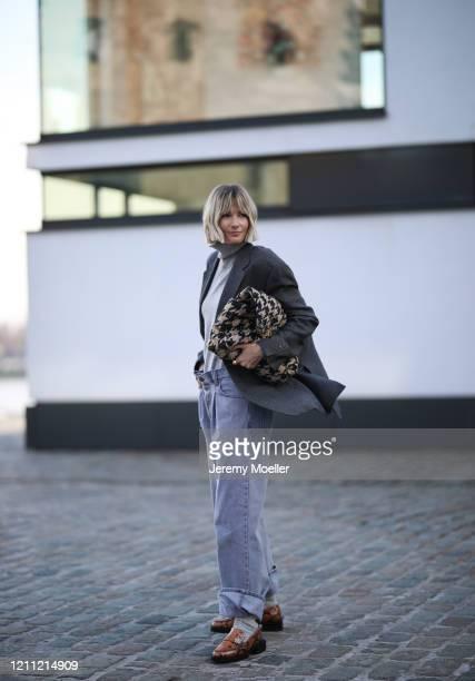 Kathrin Bommann wearing vintage ysl blazer Raey pants Uniqlo turtleneck Chanel bag and Ganni loafer on March 07 2020 in Cologne Germany