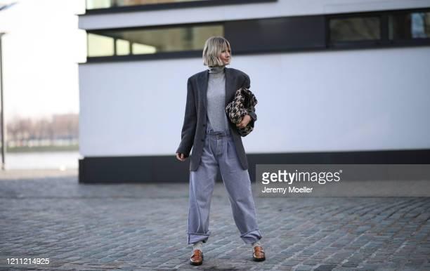Kathrin Bommann wearing vintage ysl blazer, Raey pants, Uniqlo turtleneck, Chanel bag and Ganni loafer on March 07, 2020 in Cologne, Germany.