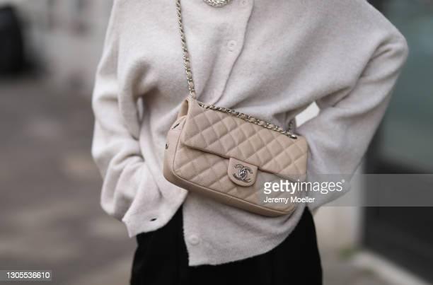 Kathrin Bommann wearing Vival cardigan, LouLou Studio pants, beige Chanel bag on February 27, 2021 in Dusseldorf, Germany.