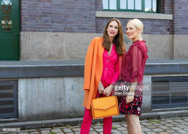 Kathrin Gelinsky and Alexandra Lapp poses during the Marc Cain Street Style shooting at WECC on July 3, 2018 in Berlin, Germany.