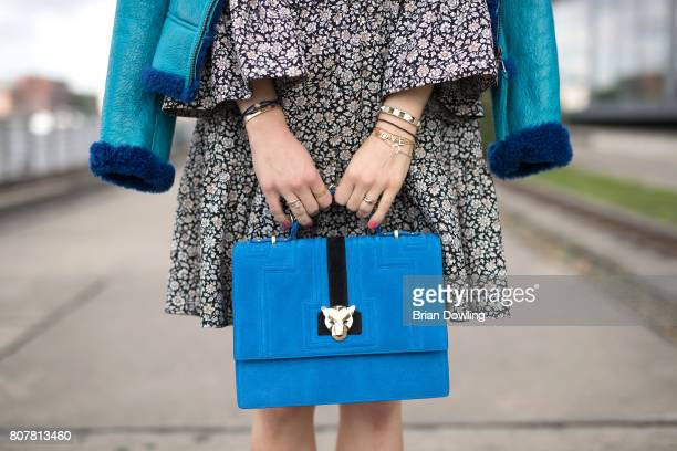 Kathrin Gelinsky bag detail poses at the Marc Cain street style shooting during MercedesBenz Fashion Week Berlin Spring/Summer 2018 on July 4 2017 in...