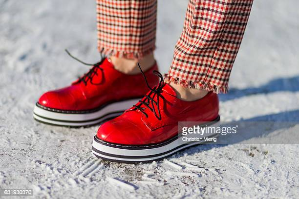 Kathrin Gelinsky wearing salmon colored checked pants red shoes Marc Cain during the MercedesBenz Fashion Week Berlin A/W 2017 on January 17 2017 in...