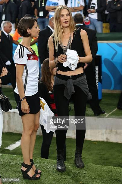 Kathrin Glich girlfriend of Manuel Neuer and Sarah Brandner girlfriend of Bastian Schweinsteiger celebrate the victory after the 2014 FIFA World Cup...