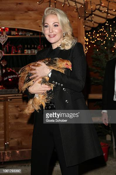 Kathrin Glock with chicken during the Gut Aiderbichl ...