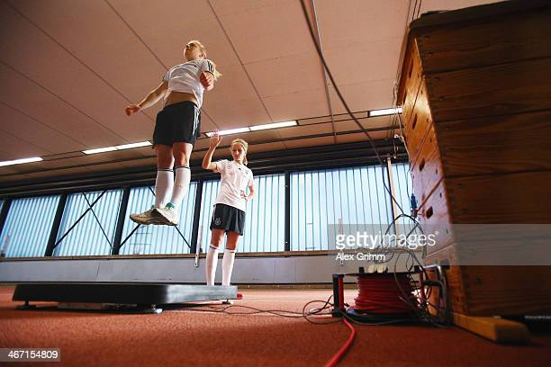 Kathrin Hendrich and Leonie Maier exercise during a performance test of the German women's national team at Sporthochschule on February 6 2014 in...