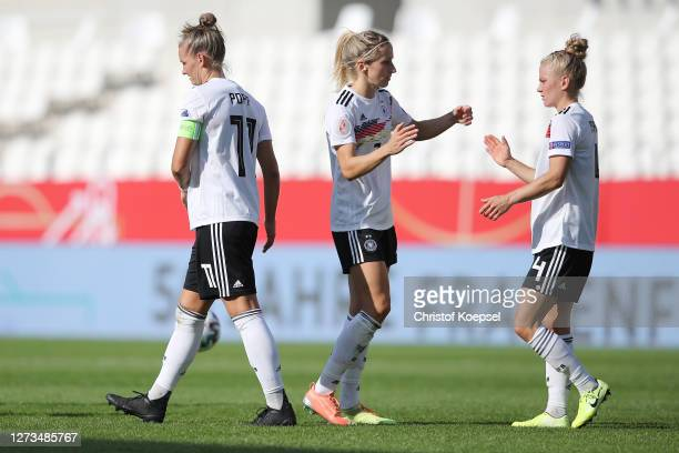 Kathrin Hendrich and Leonie Maier of Germany celebrate after winning 30 the UEFA Women's EURO 2022 Qualifier match between Germany and Ireland at...