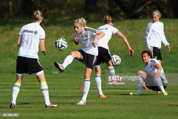 Kathrin Hendrich and team mates exercise during a Germany Women's training session at the Commerzbank Arena training ground on April 2 2014 in...