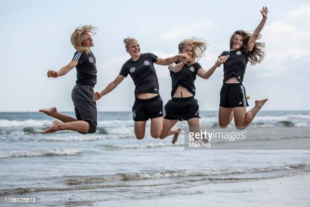 Kathrin Hendrich Leonie Maier Verena Schweers and Sara Daebritz pose for a photo as team of Germany visits the beach on June 15 2019 in La...