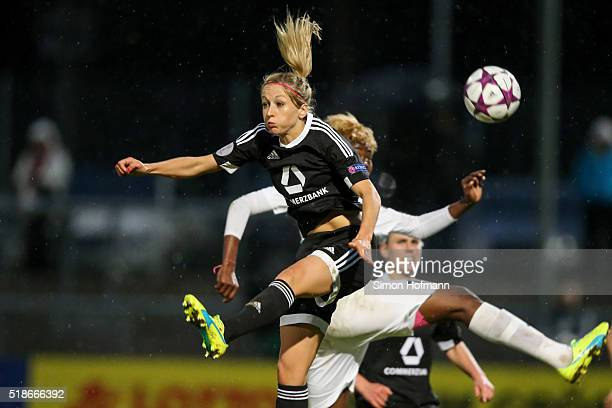 Kathrin Hendrich of Frankfurt jumps for a header with Gaelle Enganamouit of Rosengard during the UEFA Women's Champions League quarter final second...
