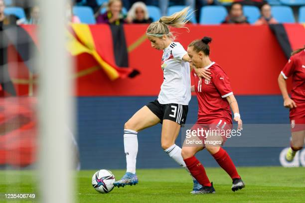 Kathrin Hendrich of Germany and Miljana Ivanovic of Serbia battle for the ball during the FIFA Women's World Cup 2023 Qualifier group H match between...