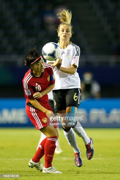 Kathrin Hendrich of Germany and Song Sicheng of China compete for the ball during the FIFA U20 Women's World Cup Japan 2012 Group D match between...