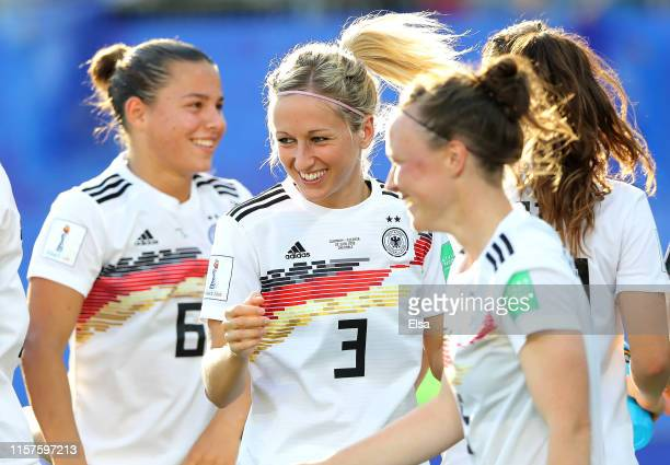 Kathrin Hendrich of Germany celebrates victory with her team mates after the 2019 FIFA Women's World Cup France Round Of 16 match between Germany and...