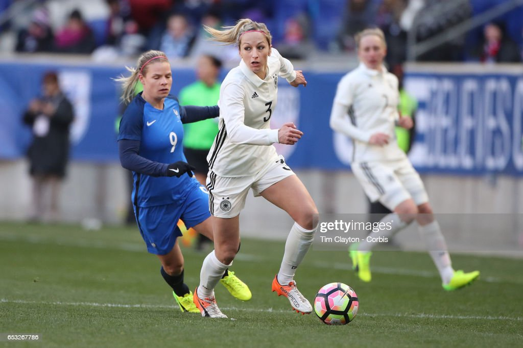 Kathrin Hendrich #3 of Germany challenged by Eugénie Le Sommer #9 of France during the France Vs Germany SheBelieves Cup International match at Red Bull Arena on March 4, 2017 in Harrison, New Jersey.
