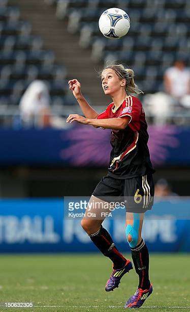Kathrin Hendrich of Germany heads the ball during the FIFA U20 Women's World Cup Japan 2012 Group D match between Ghana and Germany at Hiroshima Big...