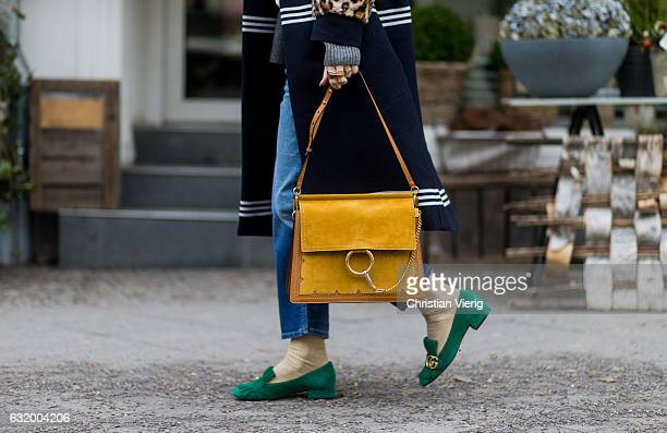 Kathrin 'Kate' Gelinsky wearing a navy Baum Pferdgarten coat Gucci shoes jeans and blouse closed Ray Ban sunglasses Chloe bag during the MercedesBenz...