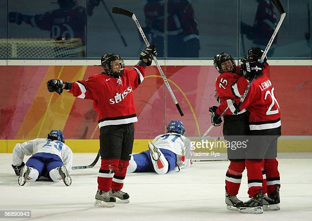 Kathrin Lehmann celebrates with Jeanette Marty of Switzerland after Lehmann scored the fourth goal in the first period during the women's ice hockey...