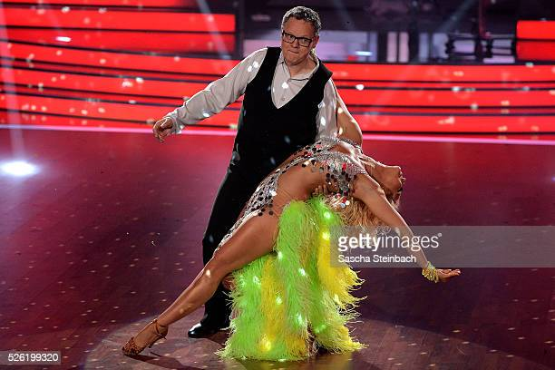Kathrin Menzinger and Ulli Potofski perform on stage during the 7th show of the television competition 'Let's Dance' at Coloneum on April 29 2016 in...