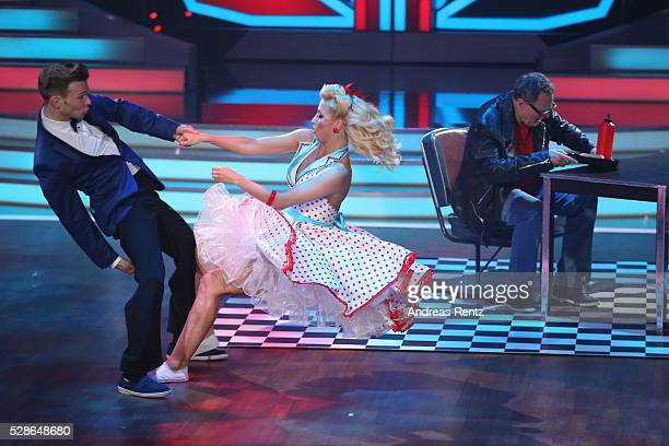 Kathrin Menzinger and Ulli Potofski^perform on stage during the 8th show of the television competition 'Let's Dance' on May 6, 2016 in Cologne,...