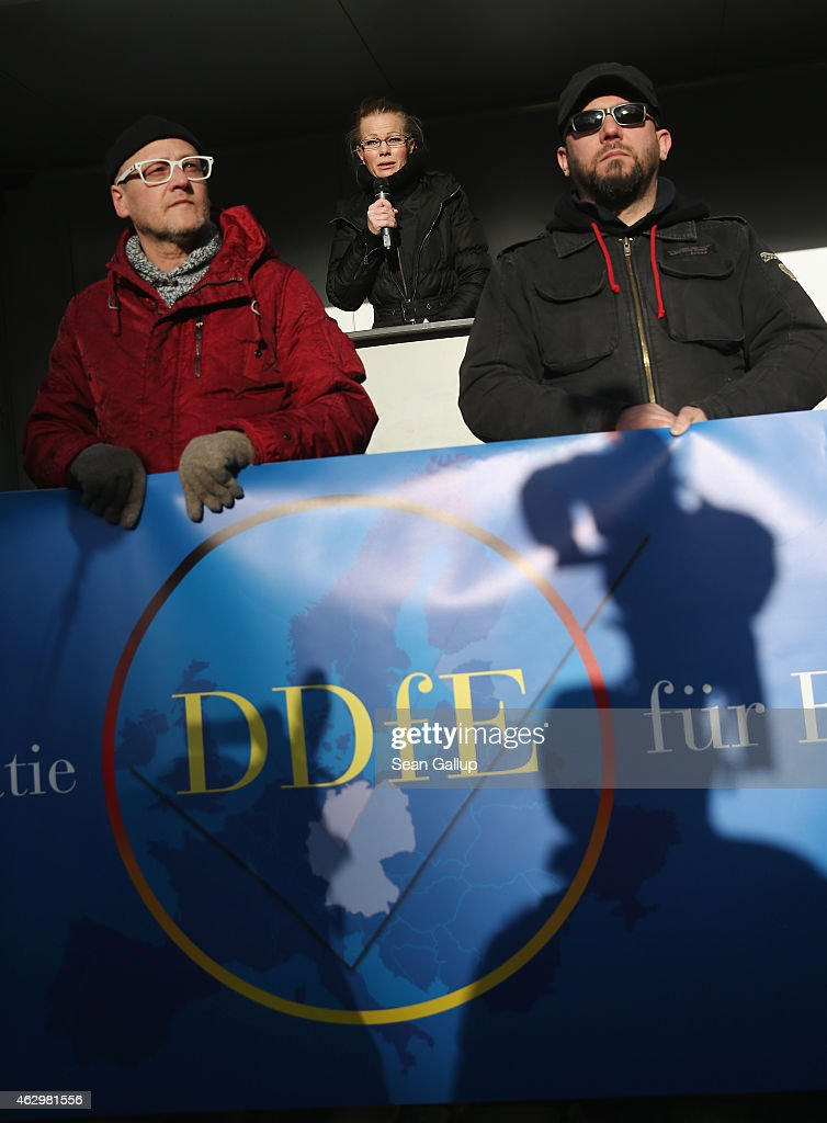 Kathrin Oertel (C), former spokeswoman for Pegida and now head of the DDfE (Direkte Demokratie fuer Europa, or Direct Democracy for Europe), speaks at the first DDfE rally on February 8, 2015 in Dresden, Germany. Oertel and several other leading Pegida members launched the DDfE after disagreements with the remaining Pegida leadership, including its founder, Lutz Bachmann, who caused controversy after Facebook postings of his emerged quoting him railing against immigrants and picturing him with an Adolf Hitler moustache and haircut. Oertel announced the DDfE seeks reform of immigration law, citizen participation over TIPP and European Union membership and a strengthening of police and fire department personnel, among other issues.