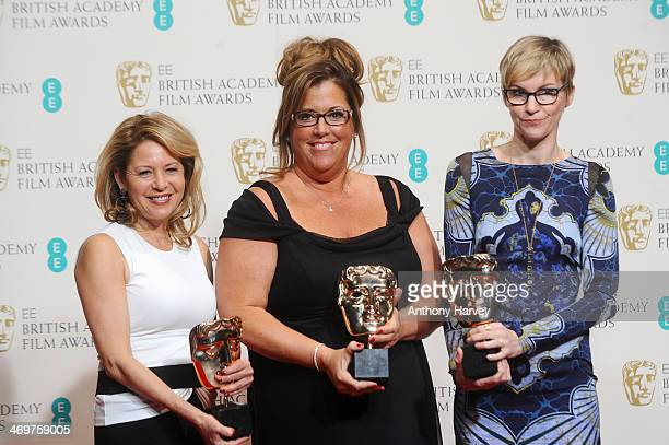 Kathrine Gordon Lori McCoyBell and Evelyne Noraz winners of the MakeUp and Hair award pose in the winners room at the EE British Academy Film Awards...
