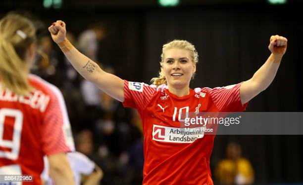 Kathrine Heindahl of Denmark celebrates after scoring a goal during the IHF Women's Handball World Championship group C match between Denmark and...