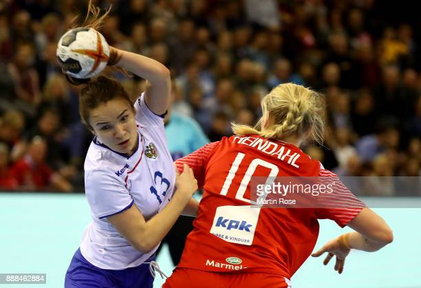 Kathrine Heindahl of Denmark challenges Anna Vyakhireva of Russia during the IHF Women's Handball World Championship group C match between Denmark...